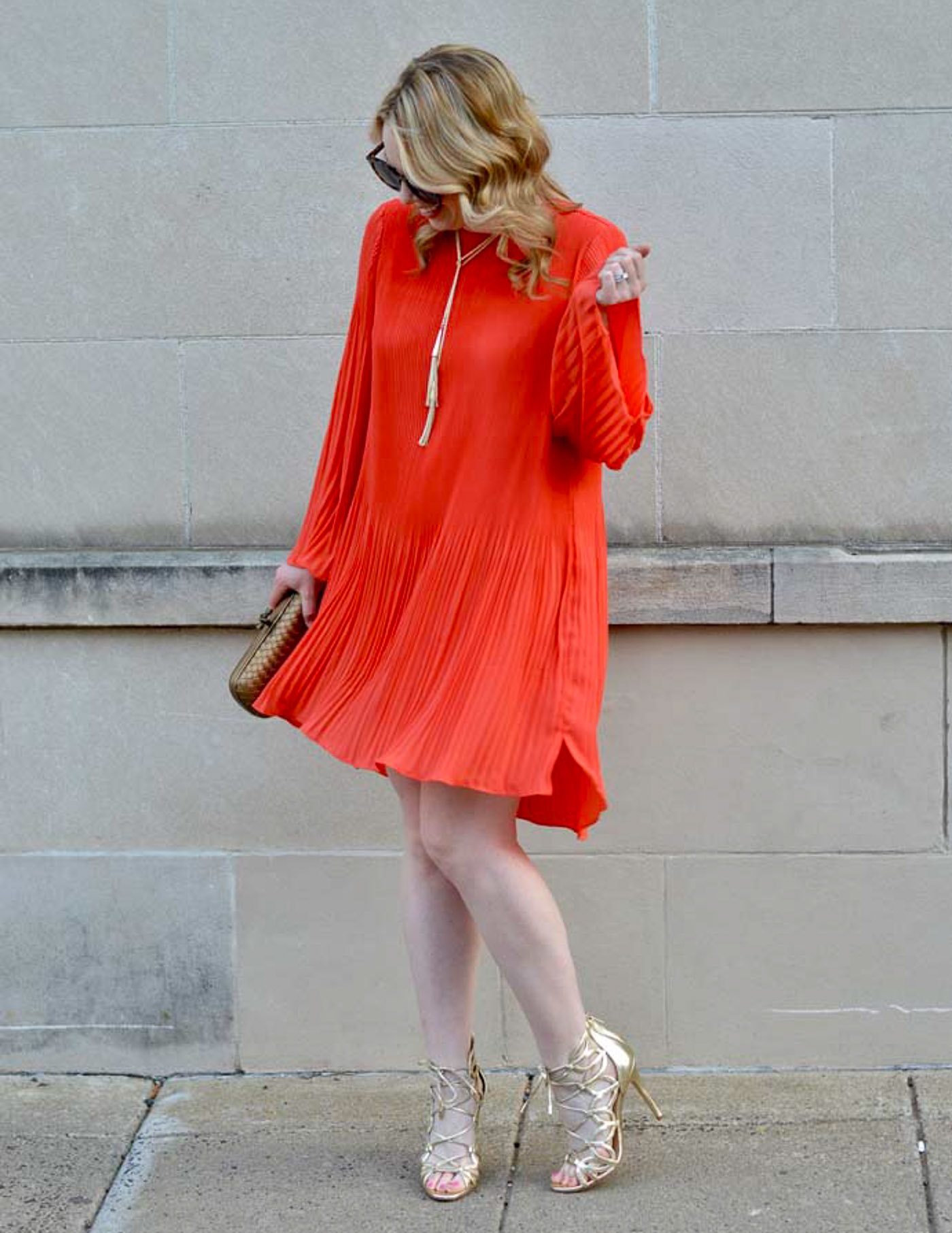 orange pleated swing dress